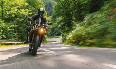 motorbike riding on the forest country road. driving on the empty road on a motorcycle tour. copyspace for your individual text.- Stock Photo or Stock Video of rcfotostock | RC-Photo-Stock