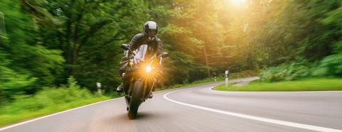 motorbike riding on the forest road. driving on the empty road on a motorcycle trip. copyspace for your individual text.- Stock Photo or Stock Video of rcfotostock | RC-Photo-Stock