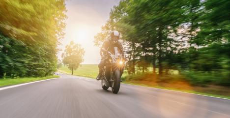 motorbike riding on the road. driving on the empty road on a motorcycle trip. copyspace for your individual text. : Stock Photo or Stock Video Download rcfotostock photos, images and assets rcfotostock | RC-Photo-Stock.: