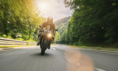 motorbike riding on the road in the mountains. driving on the empty road on a motorcycle trip. copyspace for your individual text.- Stock Photo or Stock Video of rcfotostock | RC-Photo-Stock