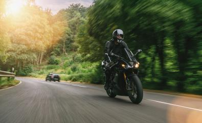motorbike riding on the road in the mountains. driving on the empty road on a motorcycle tour. copyspace for your individual text. : Stock Photo or Stock Video Download rcfotostock photos, images and assets rcfotostock | RC-Photo-Stock.: