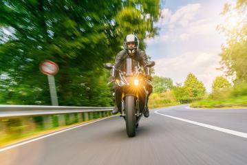 motorbike riding on the road with traffic sign. driving on the empty road on a motorcycle tour- Stock Photo or Stock Video of rcfotostock | RC-Photo-Stock