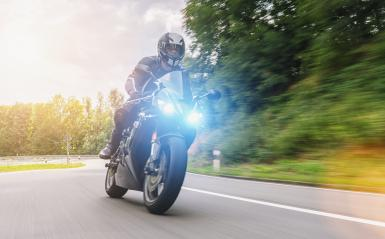motorbiker on the forest road riding. having fun driving the empty road on a motorcycle tour journey. copyspace for your individual text.- Stock Photo or Stock Video of rcfotostock | RC-Photo-Stock