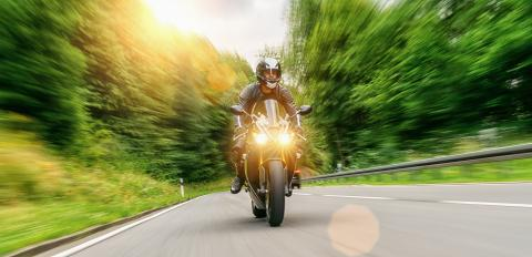 motorcycle driving on empty road at sunset. adventure freedom of single driver motorbike on highway. copy space for individual text on the right.- Stock Photo or Stock Video of rcfotostock | RC-Photo-Stock