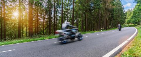 motorcycles on the forest road riding fast. having fun driving the empty road on a motorcycle tour journey. copyspace for your individual text.- Stock Photo or Stock Video of rcfotostock | RC-Photo-Stock