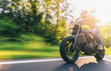 Motorrad fährt auf freier Landstrasse in den Sonnenuntergang- Stock Photo or Stock Video of rcfotostock | RC-Photo-Stock