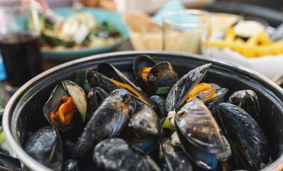 Mussels in a bowl with French fries on a restaurant.  A classic dish in Belgium, France and Netherlands. - Stock Photo or Stock Video of rcfotostock | RC-Photo-Stock
