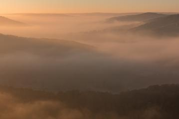 Nebel über dem Tal zum Sonnenaufgang, Warm, Herbst, Eifel : Stock Photo or Stock Video Download rcfotostock photos, images and assets rcfotostock | RC-Photo-Stock.: