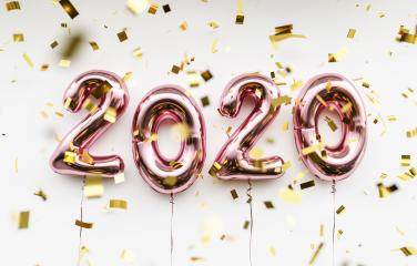 New year 2020 celebration. pink metallic foil balloons numeral 2020 and confetti on white background- Stock Photo or Stock Video of rcfotostock | RC-Photo-Stock