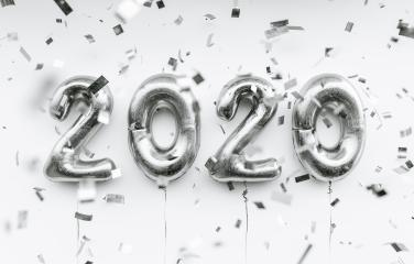 New year 2020 celebration. silver foil balloons numeral 2020 and confetti on blue background- Stock Photo or Stock Video of rcfotostock | RC-Photo-Stock