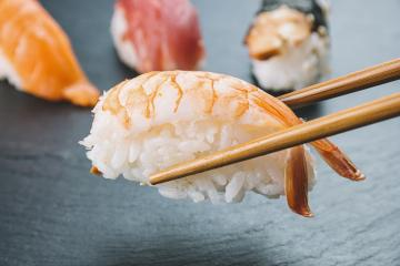 Nigiri sushi with chopsticks : Stock Photo or Stock Video Download rcfotostock photos, images and assets rcfotostock | RC-Photo-Stock.: