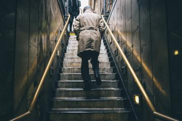 nknown older man walking up the old stone stairs during rain : Stock Photo or Stock Video Download rcfotostock photos, images and assets rcfotostock | RC-Photo-Stock.: