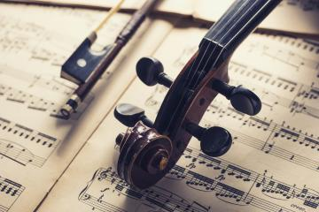old antique Violin head with bow on notes- Stock Photo or Stock Video of rcfotostock | RC-Photo-Stock
