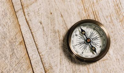 old compass on wood background concept for direction, travel, guidance or assistance- Stock Photo or Stock Video of rcfotostock | RC-Photo-Stock