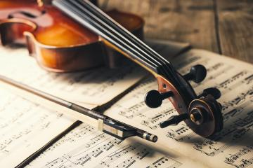 old Violin with bow on notes- Stock Photo or Stock Video of rcfotostock | RC-Photo-Stock