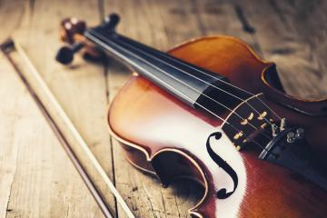 old Violin with bow on wooden background- Stock Photo or Stock Video of rcfotostock | RC-Photo-Stock