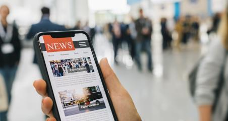 Online news on a mobile smartphone. Close up of businesswoman reading news or articles in a smartphone screen application. Hand holding smart device. Mockup website. Newspaper and portal on internet.- Stock Photo or Stock Video of rcfotostock | RC-Photo-Stock