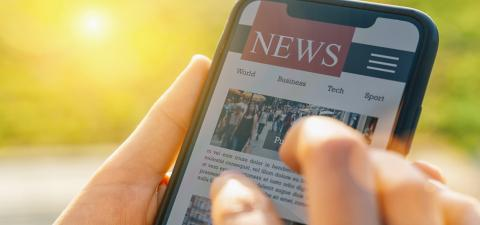 Online news on mobile phone. Close up of smartphone screen. Woman reading articles in application. Hand holding smart device. Mockup website. Newspaper and portal on internet.- Stock Photo or Stock Video of rcfotostock | RC-Photo-Stock
