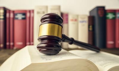 Open law book with a judge gavel and german law books in a lawyer office- Stock Photo or Stock Video of rcfotostock   RC-Photo-Stock