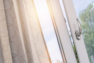 opened white plastic pvc window with curtain- Stock Photo or Stock Video of rcfotostock | RC-Photo-Stock