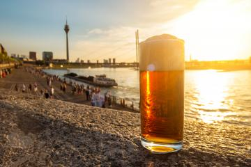 original Dusseldorfer Altbier (German traditionally beer) at the rhine shore- Stock Photo or Stock Video of rcfotostock | RC-Photo-Stock