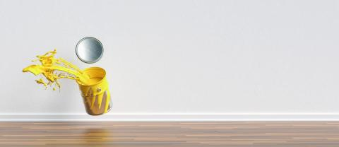 paint can splashing yellow color in a apartment with wall and copy space for individual text, renovation concept image- Stock Photo or Stock Video of rcfotostock | RC-Photo-Stock