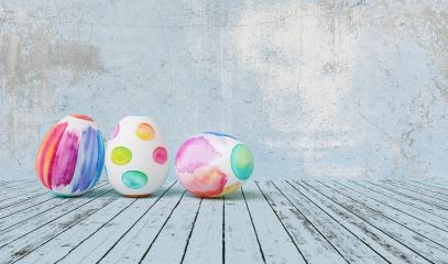 Painted easter eggs for Easter in front of a blue grunge background wall, including copy space- Stock Photo or Stock Video of rcfotostock | RC-Photo-Stock