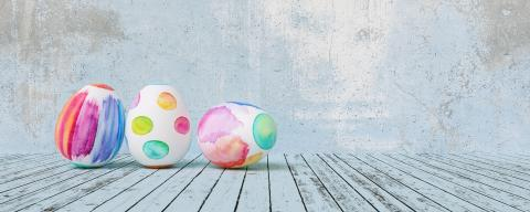 Painted easter eggs for Easter in front of a blue grunge background wall, including copy space, banner size- Stock Photo or Stock Video of rcfotostock | RC-Photo-Stock