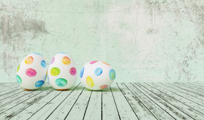 Painted easter eggs for Easter in front of a green grunge background wall, including copy space- Stock Photo or Stock Video of rcfotostock | RC-Photo-Stock