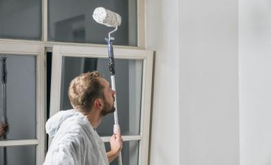 painter look to the wall with paint roller and think about his work- Stock Photo or Stock Video of rcfotostock | RC-Photo-Stock