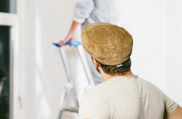 Painter working with paint roller and brushes to paint the room- Stock Photo or Stock Video of rcfotostock | RC-Photo-Stock
