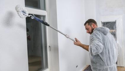 painter working with paint roller in a room to paint white color on a wall. do it yourself concept image- Stock Photo or Stock Video of rcfotostock | RC-Photo-Stock