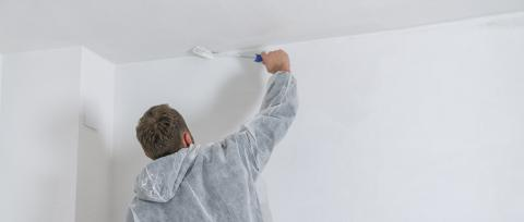painter working with paint roller to paint the ceiling of a room with white color- Stock Photo or Stock Video of rcfotostock | RC-Photo-Stock