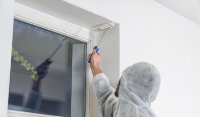 painter working with paint roller to paint the corner of a room window with white color. do it yourself concept image- Stock Photo or Stock Video of rcfotostock | RC-Photo-Stock