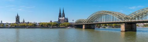 panorama of Cologne with Great St. Martin Church, Cologne Cathedral, Hohenzollern Bridge and the Rhine river- Stock Photo or Stock Video of rcfotostock | RC-Photo-Stock