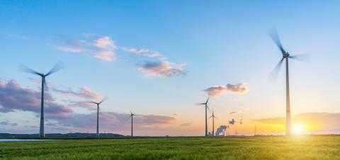 panoramic view of awind farm with coal power plant at sunset- Stock Photo or Stock Video of rcfotostock | RC-Photo-Stock