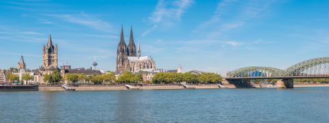 Panoramic view of the Cologne Cathedral with Hohenzollern Bridge and Rhine River in Germany, the church Great St. Martin at the left side- Stock Photo or Stock Video of rcfotostock | RC-Photo-Stock