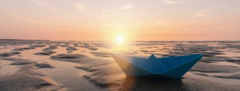 paper boat at the beach of baltic sea, romantic travel concept. copyspace for your individual text, banner size- Stock Photo or Stock Video of rcfotostock | RC-Photo-Stock