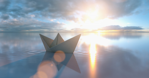 Paper boat in a calm sea at sunrise sunset with cloudy sky- Stock Photo or Stock Video of rcfotostock | RC-Photo-Stock