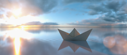 Paper boat in a calm water at sunrise sunset with cloudy sky, copyspace for your individual text.- Stock Photo or Stock Video of rcfotostock | RC-Photo-Stock
