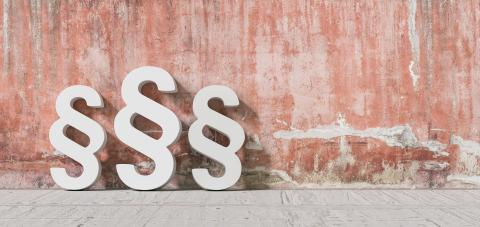 Paragraph Symbol Leaning On Red Wall- Stock Photo or Stock Video of rcfotostock | RC-Photo-Stock