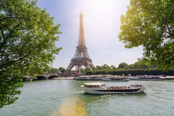 Paris Eiffel Tower and river Seine at summer in Paris, France. Eiffel Tower is one of the most iconic landmarks of Paris. - Stock Photo or Stock Video of rcfotostock | RC-Photo-Stock