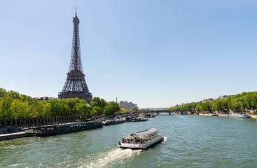 Paris Eiffel Tower and river Seine at summer in Paris, France. Eiffel Tower is one of the most iconic landmarks of Paris. copyspace for your individual text.- Stock Photo or Stock Video of rcfotostock | RC-Photo-Stock