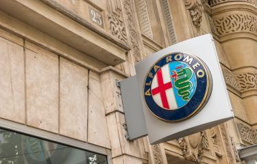 PARIS, FRANCE SEPTEMBER, 2017: Alfa Romeo motor company logo on building. Alfa Romeo Automobiles S.p.A. is an Italian manufacturer of cars.- Stock Photo or Stock Video of rcfotostock | RC-Photo-Stock