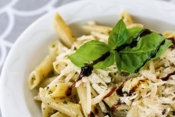 Pasta with vegetables, Parmesan and creamy sauce in a bowl on table background. Top view- Stock Photo or Stock Video of rcfotostock | RC-Photo-Stock