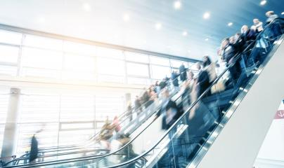 people at a moving escalator on a traid fair- Stock Photo or Stock Video of rcfotostock | RC-Photo-Stock