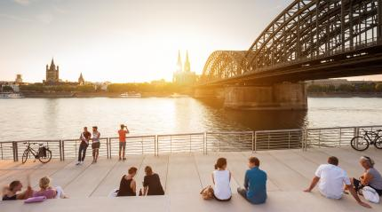 people spending their vacation in Cologne at sunset- Stock Photo or Stock Video of rcfotostock   RC-Photo-Stock