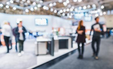 People walking on a trade show booth, generic background with a blur effect applied- Stock Photo or Stock Video of rcfotostock | RC-Photo-Stock