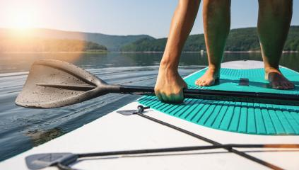 Person on paddle board tries to stand up- Stock Photo or Stock Video of rcfotostock | RC-Photo-Stock