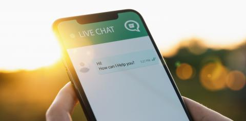 Person use customer service and support live chat with chatbot and automatic messages or human servant outdoor. Assistance and help with mobile phone app. Smartphone helpdesk for feedback cell.- Stock Photo or Stock Video of rcfotostock | RC-Photo-Stock